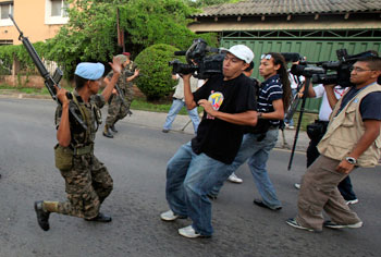 Soldiers block journalists from filming near the presidential palace in Tegucigalpa following the June 2009 coup. The government censored and obstructed news outlets after President Zelaya was ousted. (AP/Esteban Felix)