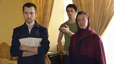 American hikers Shane Bauer, Josh Fattal, and Sarah Shourd wait to see their mothers at a hotel in Tehran, in May. (AP/Press TV)