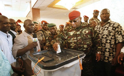 Transitional leader Sekouba Konaté casts his vote in June's historic elections in Guinea. (Reuters)