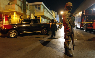 A soldier outside Televisa's Monterrey offices. (Reuters/Tomas Bravo)