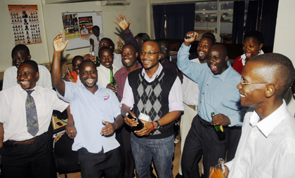 Journalists at the Monitor cheer the court's ruling to strike down sedition. (Monitor)