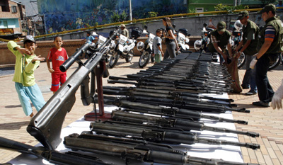Colombian authorities seize a Los Paisas weapons cache in August 2009. (Reuter/Fredy Amariles)
