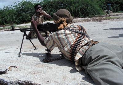 A journalist films an insurgent in Somalia. (Mohammed Ibrahim)