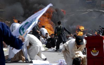 Mayhem follows a suicide bombing in Quetta. (AP/Arshad Butt)