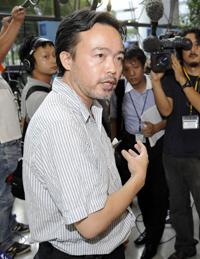 Tsuneoka arrives in Japan on Tuesday. (Reuters/Kyodo)