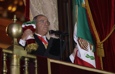 """Calderón, seen here at recent Independence Day celebrations, says he is """"pained"""" by anti-press violence in Mexico. (AP/Dario Lopez-Mills)"""