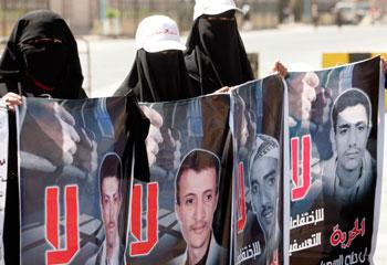 Protesters in Sana'a denounce extrajudicial detentions. (Reuters/Khaled Abdullah)