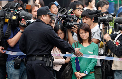 Chinese journalists, seen here at a police roadblock, are contesting harassment more publicly. (AP)