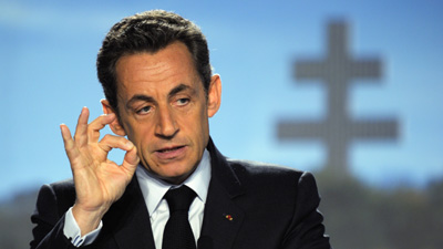 """Le Carnard says Sarkozy is spying on reporters. His office calls the claim """"grotesque."""" (Reuters/Philippe Wojazer)."""
