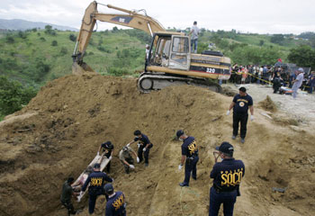 Forensic evidence was compromised by flawed crime scene methods, including the use of backhoes. (AP/Aaron Favila)