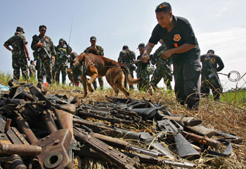 Police seized weapons from the Ampatuan clan but delayed turning them over to prosecutors. (AP/Pat Roque)