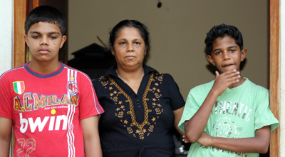 Sandhya Eknelygoda and sons Sanjay and Harith. (CPJ)