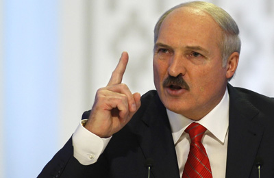Belarusian President Aleksandr Lukashenko speaks in Minsk on December 20, the same day riot police forcibly dispersed thousands of demonstrators protesting the results of a flawed presidential vote. (AP/Sergei Grits)