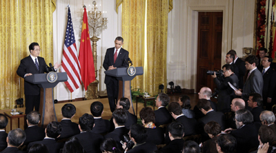 Reporters push Hu to respond to press freedom concerns. (AP/Charles Dharapak)