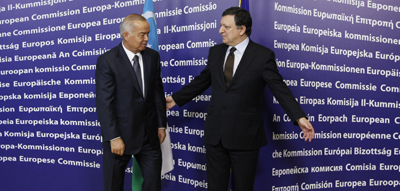 After defying the EU for years, Uzbek President Islam Karimov is welcomed by Jose Manuel Barroso, president of the European Commission. (Reuters/Thierry Roge)