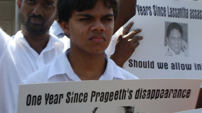 The son of missing cartoonist Prageeth Eknelygoda seeks justice at a Colombo rally. (Paba Deshapriya)