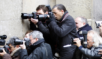 Dolega, center standing, is seen on assignment in 2008. He died from head injuries suffered while covering street protests in Tunis. (Reuters/Charles Platiau)