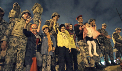 Soldiers and children celebrate in Tahrir Square. (AP/Ben Curtis)