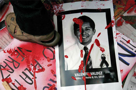 At a Mexico City protest against anti-press violence, a poster recalls the slain journalist Valentine Valdés Espinosa (AP/Marco Ugarte)