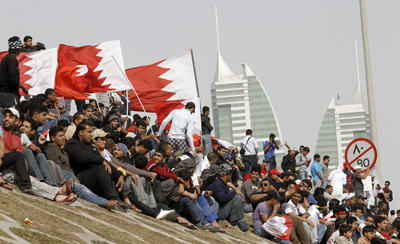 Bahraini anti-government protesters take a rest from demonstrations in central Manama, Bahrain. (Reuters/Hamad I Mohammed)