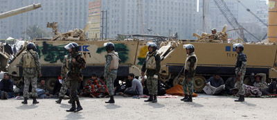 Protesters gather around army vehicles in Cairo's Tahrir Square. (Reuters)