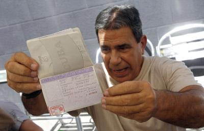 Gálvez Rodríguez shows his passport to the media after his arrival in Spain. (Reuters)