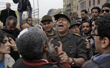 An Egyptian general walks through protests in Tahrir Square. (AP)