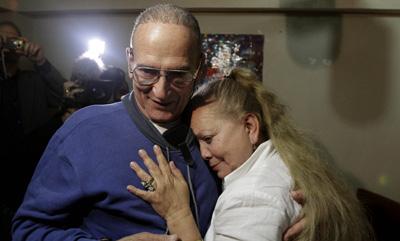 Freed journalist Héctor Maseda Gutiérrez embraces his wife, Laura Pollán, leader of Cuban dissident group Ladies in White, in his home in Havana. (AP/Franklin Reyes)