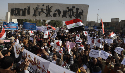 Military forces rounded up journalists in Baghdad's Tahrir Square, seen here today. (AP/Karim Kadim)