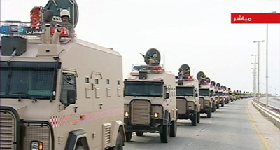 Saudi troops roll into Bahrain in this still image from Reuters video. (Reuters)