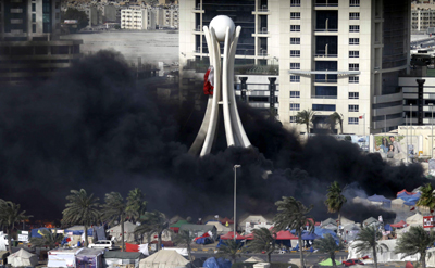 Police break up a protest camp in Manama's Pearl Square. (AFP/Joseph Eid)