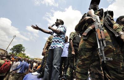 Gbagbo youth leader Charles Blé Goudé urges supporters to take up arms. (AFP/Sia Kambou)