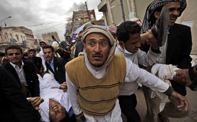 A protester shot by government forces is carried from the scene.(AP/Muhammed Muheisen)