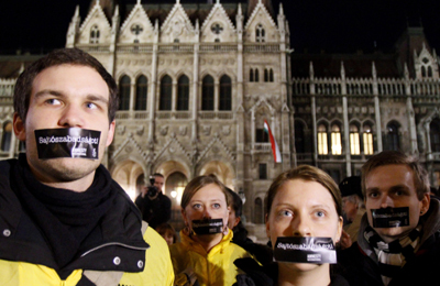 Hungarians protest the country's new media law outside parliament. (Bernadett Szabo/Reuters)