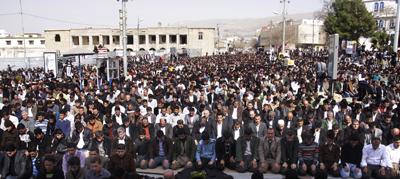 Kurdish demonstrators pray in Sulaimaniya following protests. (AFP/Shwan Mohammed)