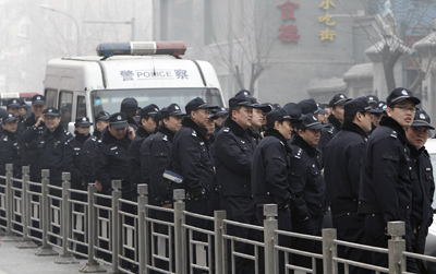 """Chinese police stand guard near a planned protest site for the """"Jasmine Revolution"""" on February 20 in Beijing. (AP/Andy Wong)"""