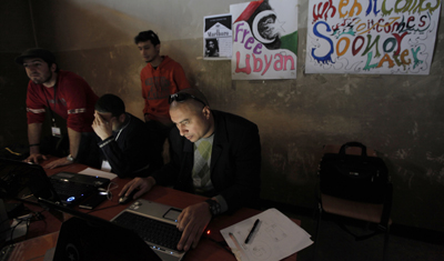 Libyan uprising activists set up a media center headquarters in Benghazi that provides technical support to journalists, documents collected media material, and communicates with foreign media. (AP/Nasser Nasser)