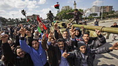 Residents cheer as foreign journalists arrive in Zawiya, 30 miles (50 kilometers) west of Tripoli on Sunday. (AP/Ben Curtis)