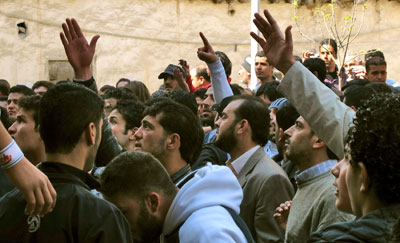 Syrians shout slogans in support of protesters in Deraa. (Reuters)