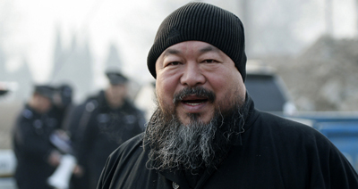 Michael Posner said he does not feel comforted from the response or lack of response on the recent detention of Ai Weiwei, seen here. (AP/Andy Wong)