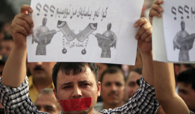Protesters denounce anti-press violence in Iraqi Kurdisatn in this 2010 demonstration. (AP/Yahya Ahmed)