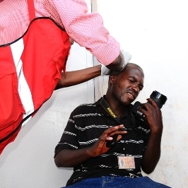 Photojournalist Michael Kakumirizi is treated for a head wound sustained during the Walk to Work protest. (Edward Echwalu)