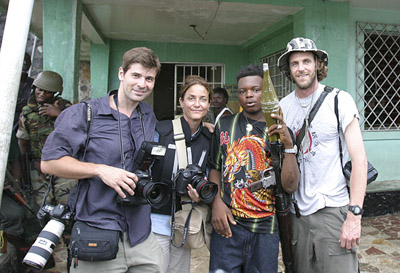 Chris Hondros, Carolyn Cole, a rebel fighter, and the author in Liberia. (Courtesy Nic Bothma)
