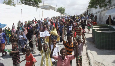Somali protesters march in Mogadishu, taking to the streets for a second day. (AP/Farah Abdi Warsameh)