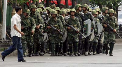Chinese police patrol Urumqi following ethic violence in July 2009. (Reuters)