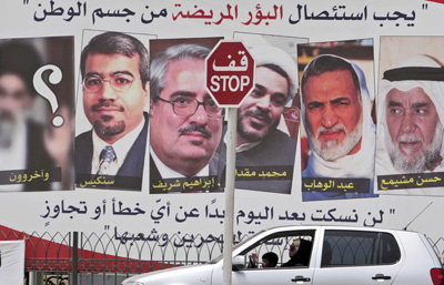 The sign, which depicts some of the men sentenced today, reads at the top: 'Disease must be excised from the body of the nation.' (AP/Hasan Jamali)