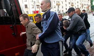 Belarus plainclothes policemen detain protesters during a Minsk protest on Wednesday. (AP)