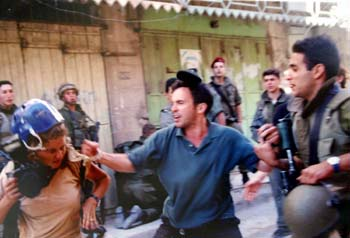 Levine, far left, faces harassment from a Jewish settler in Hebron. (AP)