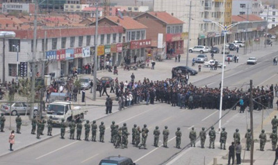 Paramilitary police block the street during a protest in Xilinhot, Inner Mongolia. (Reuters/Southern Mongolian Human Rights Information Center/Handout)