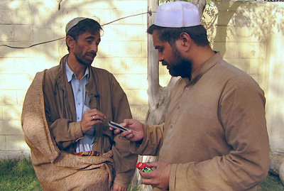 Syed Saleem Shahzad, right, with Pakistani journalist Qamar Yousafzai at the Afghan border in 2006 after being released by the Taliban. (AP)